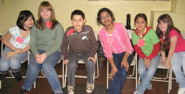 Lily, Nikol, George, Tasnia, Esmeralda, and Katherine pose before participating in their final spelling bee at PS 124!